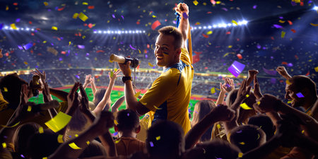 stadium: Fans on stadium soccer game Confetti and tinsel