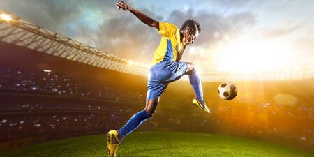 football player: Black soccer player in action. Stadium field Panorama Wiev