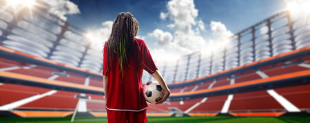the girl is young: Young sexy woman player in soccer stadium Day