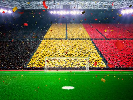campeonato de futbol: Bandera de B�lgica de fans.Evening estadio arena campo de f�tbol ganar el campeonato. Confeti y oropel Azul de tonificaci�n Foto de archivo