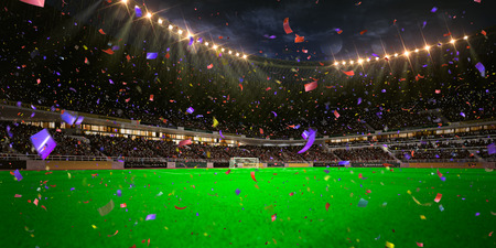 Night stadium arena soccer field championship win. Confetti and tinsel Stock fotó
