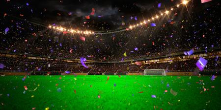 soccer fans: Night stadium arena soccer field championship win. Confetti and tinsel Stock Photo