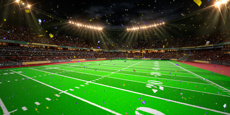football on the field: Night stadium arena Football field championship win.  Confetti and tinsel. Stock Photo
