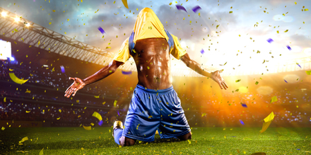 soccer player: Black soccer player winner. confetti and tinsel