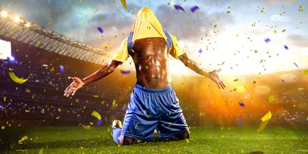 Black soccer player winner. confetti and tinsel