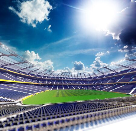 sunlight sky: Empty soccer stadium in sunlight blu sky Stock Photo