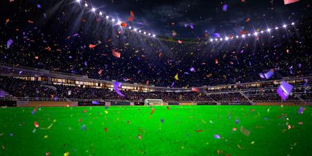 floodlit: Night stadium arena soccer field championship win. Confetti and tinsel Stock Photo