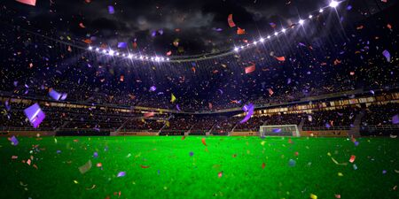 Night stadium arena soccer field championship win. Confetti and tinsel . blue toning