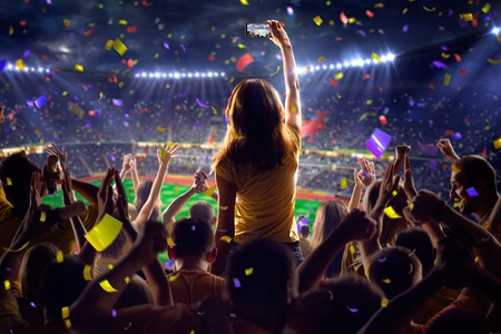 Fans on stadium soccer game Confetti and tinsel Stock Photo - 48378220