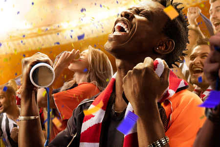 cheer: stadium soccer fans emotions portrait black man Stock Photo