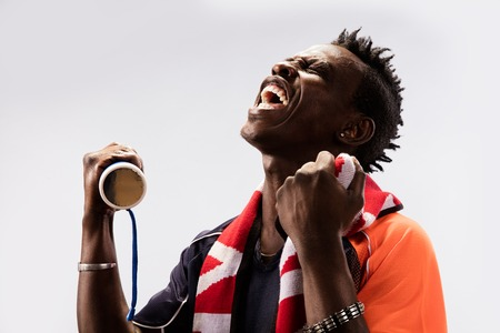 black Soccer fan in action emotions isolated