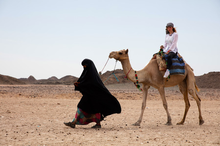 woman ride in camel desert location egypt
