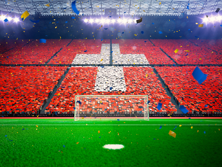 Flag Switzerland of fans.Evening stadium arena soccer field championship win. Confetti and tinsel Blue Toning