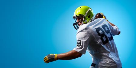 American football sportsman player on blue gradient background. Sport advertising
