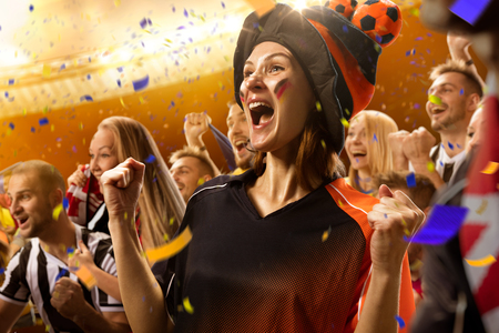 stadium soccer fans emotions portrait in yellow toning Stock Photo