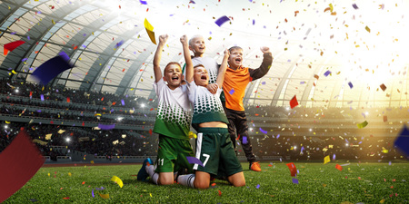 winning football player Children after score in a match confetti and tinsel Imagens