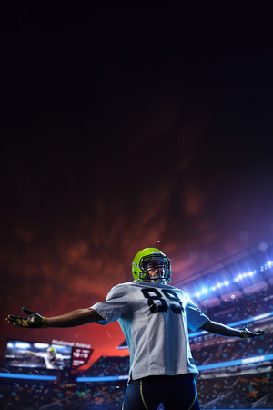 American football player celebrate tocuhdown on stadium. Sport wallpaper or advertising