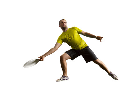 Sportsman plays ultimate, the game with flying disc. One athlete gives passes, isolated in white background