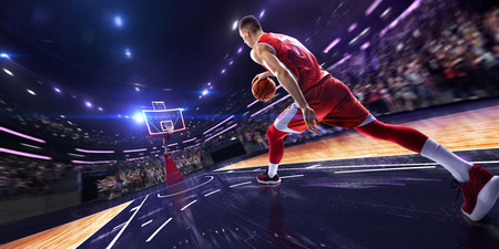 Basketball player make block shot in jump. around Arena with blue light spot