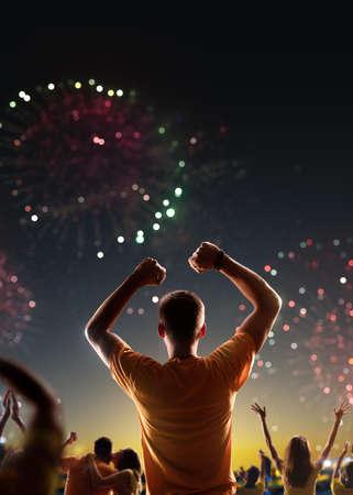 Fans celebrate in Stadium Arena night fireworks