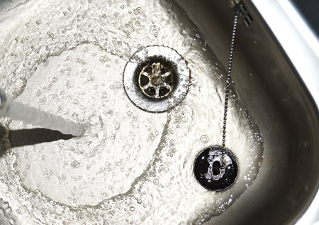 fitted unit: Stainless steel sink Stock Photo