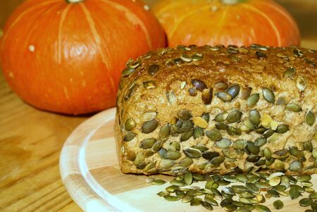 breadboard: Pumpkin seed bread with grains on a breadboard Stock Photo