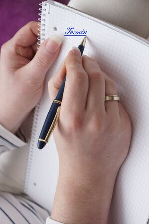 naturopaths: Very beautiful woman hand with a pen Stock Photo