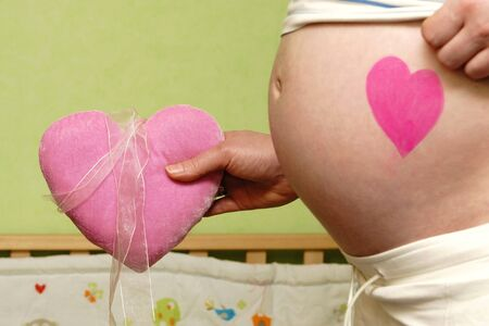 birth prevention: Very beautiful belly of a pregnant woman