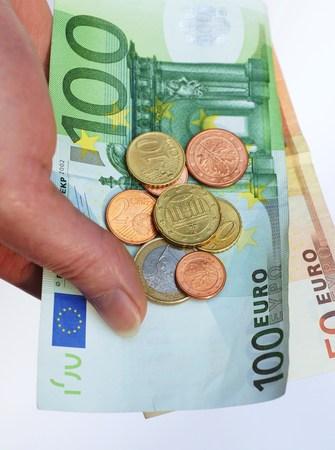 alimony: Money in woman hand Stock Photo