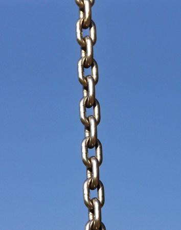 fingering: Long steel chain under blue sky Stock Photo