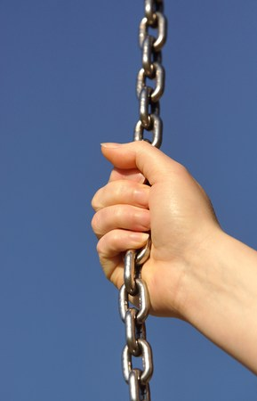 fingering: Woman hand and steel chain