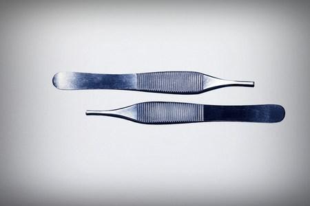 suture: Tweezers Stock Photo