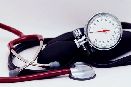 Sphygmomanometer and stethoscope on white background