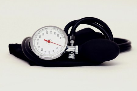 home birth: Sphygmomanometer on white background