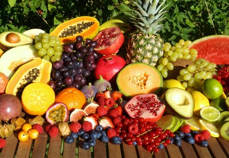 tropical fruits: Fresh tropical fruits on a wooden table