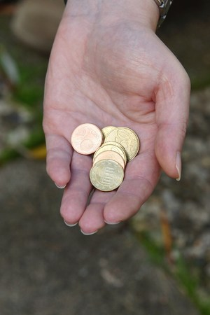 woman  hand: Euro coins in woman hand Stock Photo