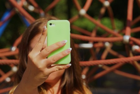 womans: Mobile phone in a beautiful womans hand