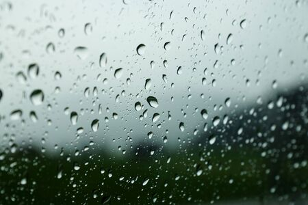 precipitation: Raindrops on a car window