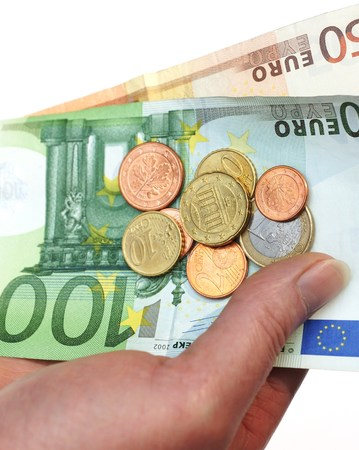 batch of euro: Euro coins and banknotes in a beautiful womans hand