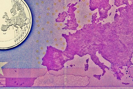 batch of euro: Euro coin on a euro banknote Stock Photo