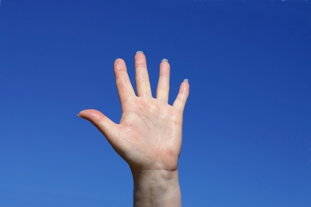 bodyparts: Beautiful woman hand in summer under blue sky Stock Photo