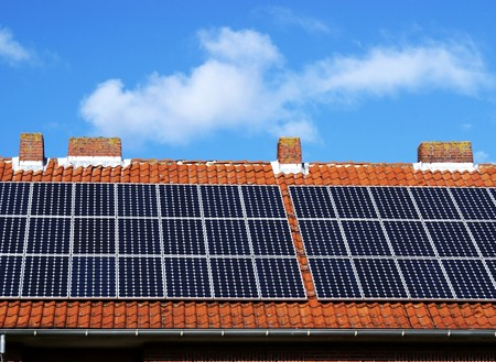 solarcell: Large solar plant in the summer on a roof Stock Photo