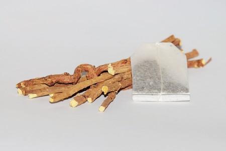expectorant: Licorice root sticks on white background