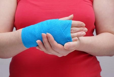 elbow bandage support: Woman hand and bandage, white background