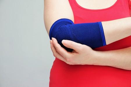 Woman hand and bandage, white background