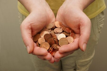 forgery: Many euro cent coins in woman hand