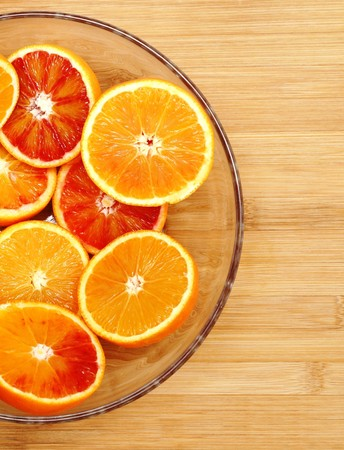 glass bowl: Fresh organic oranges in a glass bowl Stock Photo