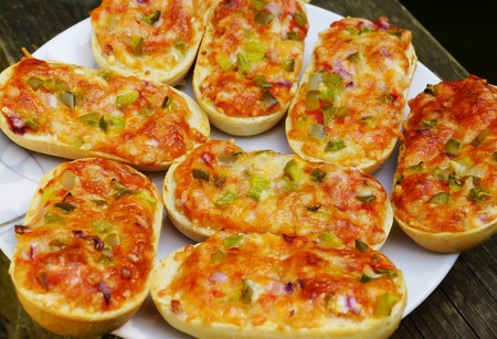 titbits: Fresh baked pizza baguette with vegetable on a plate Stock Photo