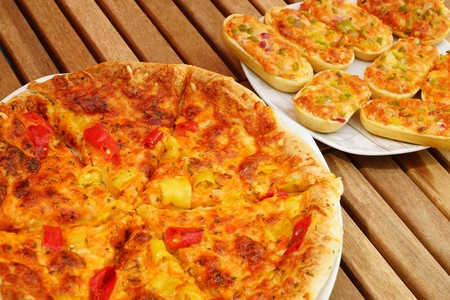 titbits: Great fresh pizza with vegetables on a plate