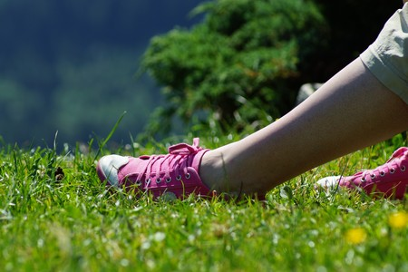 Beautiful woman legs and pink sneakers Stock Photo